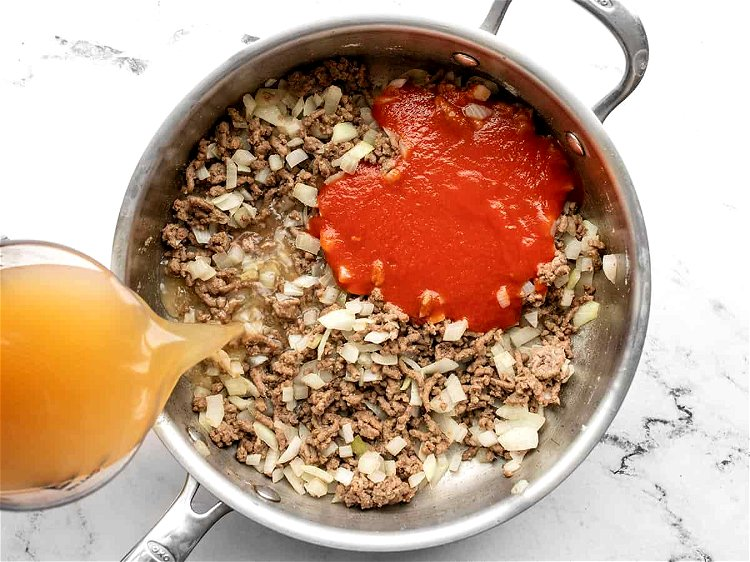 Image of Add the tomato sauce and beef broth to the skillet...