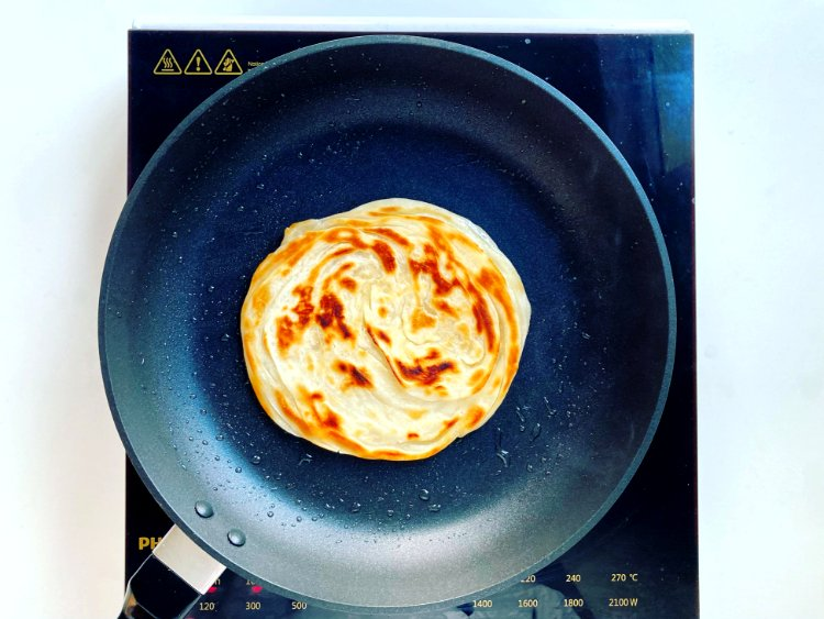Image of Grill ParanthasIn a flat non-stick pan, add half of the...