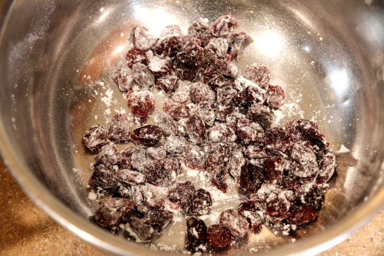 Image of Place the cherries into a bowl and toss with a...