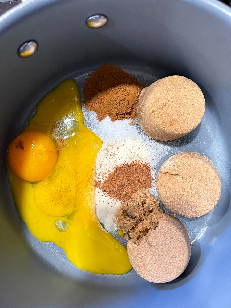 Image of Add the eggs to the saucepan and stir to combine.